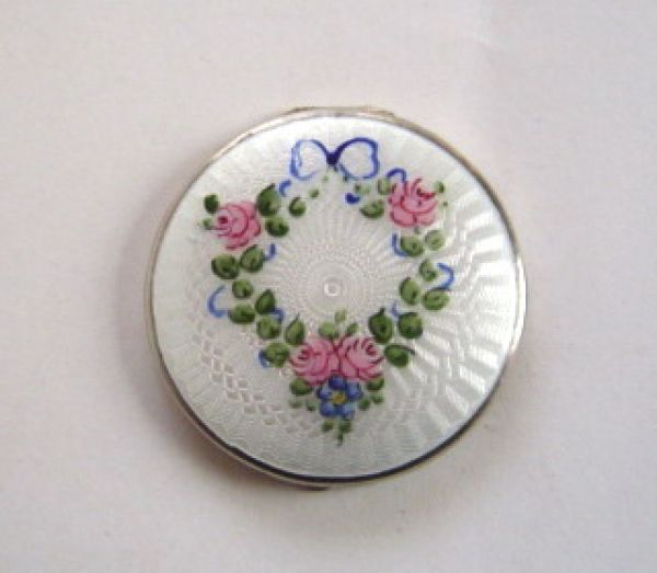 Tiny silver and enamel powder compact