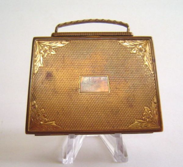Mascot handbag shaped compact
