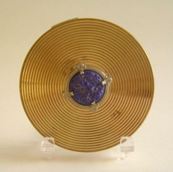 Evans compact with blue bakelite decoration